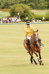 Asprey World Class Cup polo held at Hurtwood Park Polo Club, Ewhurst, Surrey on 17th July 2010.<br /> Picture shows:-AMY GUY
