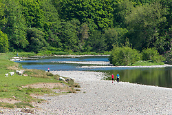 © Licensed to London News Pictures. 27/05/2020. Builth Wells, Powys, Wales, UK. People enjoy the beautiful warm weather by the River Wye at Builth Wells in Powys, UK. Wales remains under lockdown. It has been remarked by some Welsh people that Mark Drakeford, First Minister of Wales, who has not followed Boris Johnson's policies, always seems to take the opposite stance of Westminster. Photo credit: Graham M. Lawrence/LNP