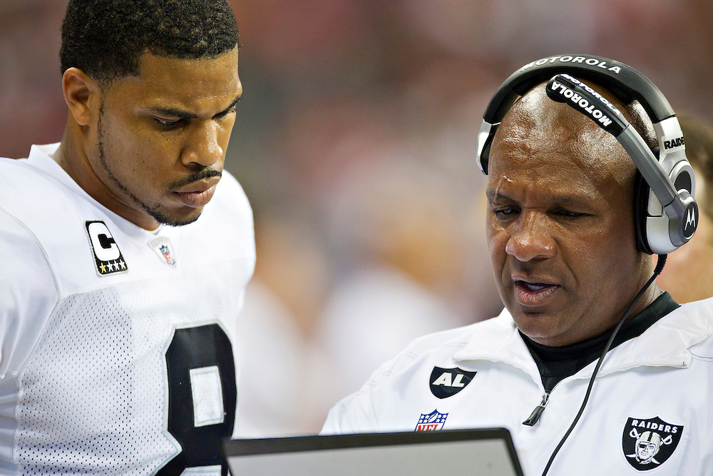 HOUSTON, TX - OCTOBER 9:   Head Coach Hue Jackson and quarterback Jason Campbell #8 of the Oakland Raiders talk on the sidelines during a game against the Houston Texans at Reliant Stadium on October 9, 2011 in Houston, Texas.  The Raiders defeated the Texans 25 to 20.  (Photo by Wesley Hitt/Getty Images) *** Local Caption *** Hue Jackson; Jason Campbell