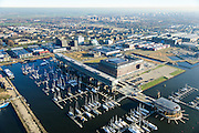Nederland, Noord-Holland, Amsterdam, 11-12-2013; Amsterdam-Noord, jachthaven Amsterdam Marina, onderdeel voormalige NDSM-werf. Het langwerpige gebouw is Kraanspoor.<br /> Amsterdam Marina, part former NDSM shipyard.<br /> luchtfoto (toeslag op standaard tarieven);<br /> aerial photo (additional fee required);<br /> copyright foto/photo Siebe Swart.