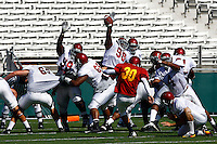 21 August 2008: PK #30 Joe Houston kicks the ball over the defense during USC Trojans Pac-10 NCAA College football team final intrasquad scrimmage of fall camp in front of 8,000 fans in the Los Angeles Memorial Coliseum near school campus.  White team (1st and 2nd teamers) defeated the Cardinal (reserves) team 28-7 on Thursday.
