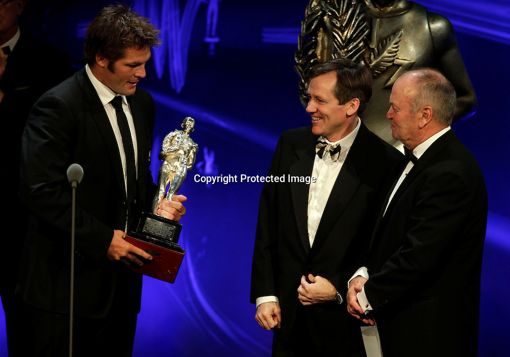 Former All Black captain David Kirk presenst the Supreme Halberg Award to All Black captain Richie McCaw and former coach Sir Graham Henry during the 2012 Westpac Halberg Awards at the Sky City Convention Centre, Auckland, New Zealand. Thursday 9 February 2012. Photo: Simon Watts/photosport.co.nz