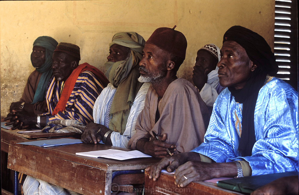 Enthusiastic pupils pay close attention in an adult class on budget techniques. Kouakourou, Mali. (Supporting image from the project Hungry Planet: What the World Eats.)