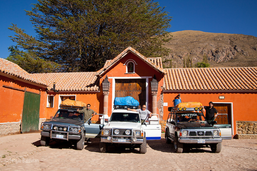 A group of 4x4 Nissan Patrol vehicles line up at the colonial-era Hacienda Cayara, near Potosi.  Hacienda Cayara is now a hostel and living museum for tourists from around the world.