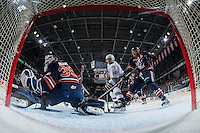 KELOWNA, CANADA - MARCH 5: Rourke Chartier #14 of Kelowna Rockets is checked by Dallas Valentine #6 in front of the net of Connor Ingram #39 of Kamloops Blazers on March 5, 2016 at Prospera Place in Kelowna, British Columbia, Canada.  (Photo by Marissa Baecker/Shoot the Breeze)  *** Local Caption *** Rourke Chartier; Dallas Valentine; Connor Ingram;