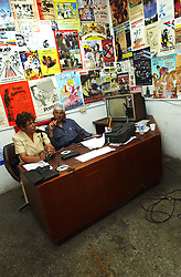 """Jose Ovalles,right, and Elida Polanco co-host the radion program """"Searching for America"""" on Radion Perola, a community radio station in western Caracas.  This episode of the show was mostly focused on pro-Chavez and anti-US rhetoric.  Chavez and his government have been increasingly supportive of these generally Chavista community media stations as a response to the anti-chavista private media."""