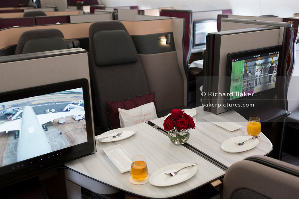 Business Class meals and luxury seating in a Qatar Airways Airbus A350-1000 at the Farnborough Airshow, on 18th July 2018, in Farnborough, England.