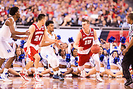 06 APR 2015:  Forward Sam Dekker (15) of the University of Wisconsin works the perimeter in front of Guard Quinn Cook (2) of Duke University during the championship game at the 2015 NCAA Men's DI Basketball Final Four in Indianapolis, IN. Duke defeated Wisconsin 68-63 to win the national title. Brett Wilhelm/NCAA Photos