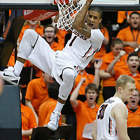 Oregon State's Gary Payton II reacts after a dunk in the first half of an NCAA college basketball game agaisnt USC, in Corvallis, Ore., on Sunday, Jan. 24, 2016.  (AP Photo/Timothy J. Gonzalez)