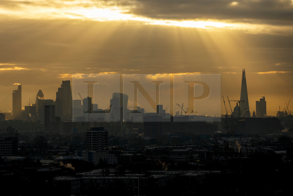 © Licensed to London News Pictures. 06/01/2017. London, UK. Sunrise over the city of London as seen from Parliament Hill on Hampstead Heath in north London on a cold winter morning of Friday, 6 January 2016. Photo credit: Tolga Akmen/LNP