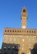 The Palazzo Vecchio. Town hall of Florence, Italy. A huge Romanesque fortress-palace overlooking the Piazza della Signoria. Designed by the architect Arnolfo di Cambio in 1299. A stonework cubicle building forms the base, crowned with a projected battlement clock tower. The current clock was made by Vincenzo Viviani in 1667. Arches in the structure are decorated with the 9 coats of arms of the Florentine Republic.