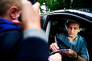 NETHERLANDS, HOENDERLOO : Dutch international football player Luuk de Jong  signs autographs as he arrives for the dutch trainingcamp of the Netherlands national football team in Hoenderloo on May 31, 2012. AFP PHOTO/ ROBIN UTRECHT