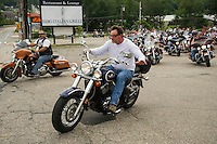 Riders leave the Fara Italian Grille parking lot on Saturday morning for the13th annual Brenda's Ride with Friends.  Proceeds to benefit LRGHealthcare Oncology Department.   (Karen Bobotas/for the Laconia Daily Sun)