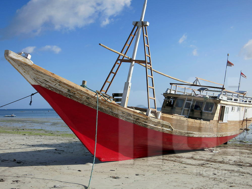 A Phinisi boat moored on shore in Tanah Beru, South Sulawesi, Indonesia, Southeast Asia