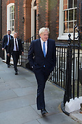 On the day that the Conservative Party elects its leader and the country's Prime Minister, and followed by close protection police officers, Boris Johnson leaves the property of Great College Street that he and his campaign team have been using (courtesy of Sky TV executive Andrew Griffith) before the result at the QE2 Centre nearby, on 23rd July 2019, in Westminster, London, England.