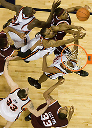 Virginia Cavaliers forward Adrian Joseph (30) reaches for a rebound against VT.  The Virginia Cavaliers Men's Basketball Team defeated the Virginia Tech Hokies 69-56 at the John Paul Jones Arena in Charlottesville, VA on March 1, 2007.