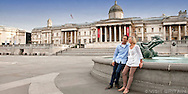 Couple in Trafalgar Square with the National Gallery in the background. Photographed for Visit Britain as part of their 2013 culture campaign. THIS IMAGE IS COPYRIGHT VISIT BRITAIN.