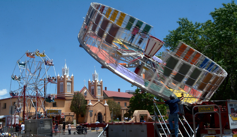gbs060417j/ASEC -- A Ferris Wheel and the Round Up rides spin in Old Town Plaza during the San Felipe de Neri Fiesta on Sunday, June 4, 2017. (Greg Sorber/Albuquerque Journal)
