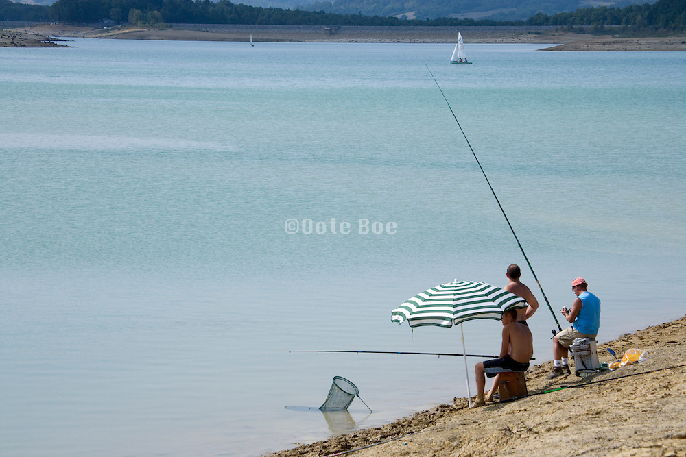 recreational fishing at a lake shore