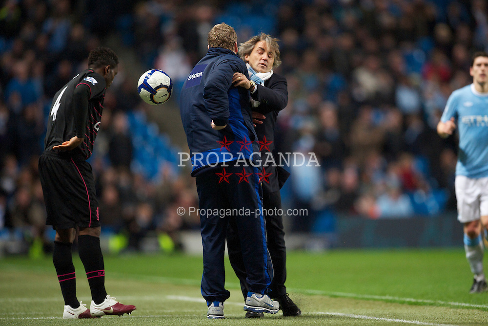 MANCHESTER, ENGLAND - Wednesday, March 24, 2010: Manchester City's manager Roberto Mancini challenges Everton's manager David Moyes as he tries to get the ball in injury time during the Premiership match at the City of Manchester Stadium. (Photo by David Rawcliffe/Propaganda)