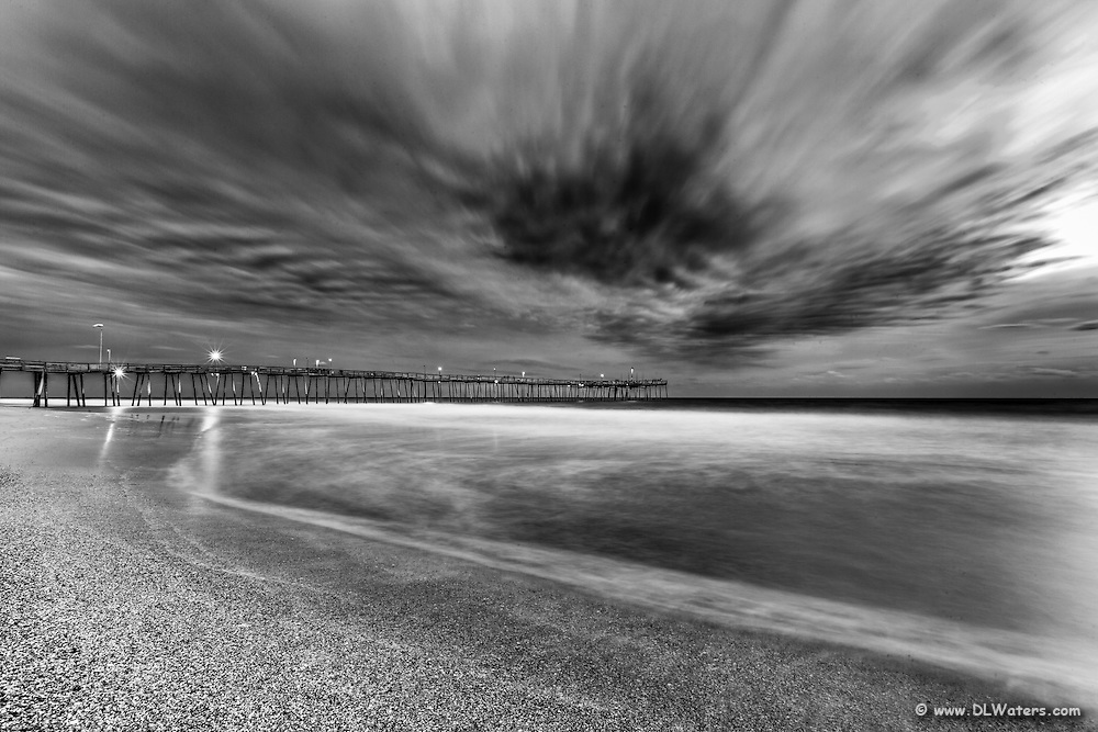 A long shutter speed shows motion in the waves and the clouds at Avalon Fishing Pier.