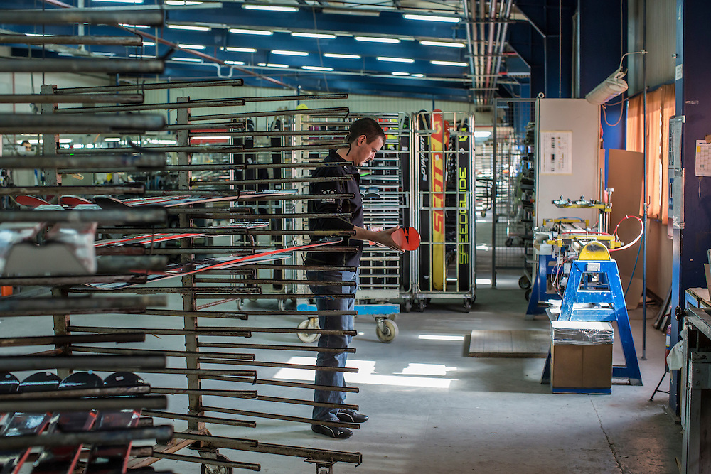 MUKACHEVO, UKRAINE - FEBRUARY 25, 2016: A worker at the Fischer-Mukachevo factory holds a finished ski in Mukachevo, Ukraine. The plant fabricates skis as well as hockey sticks, many of which are produced for export. CREDIT: Brendan Hoffman for The New York Times