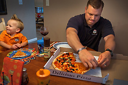 Army Staff Sgt. Jeffery Gliztow shares pizza with his family including son Dylan, 4, at their home, Fort Dix, N.J., Sept. 16, 2011.