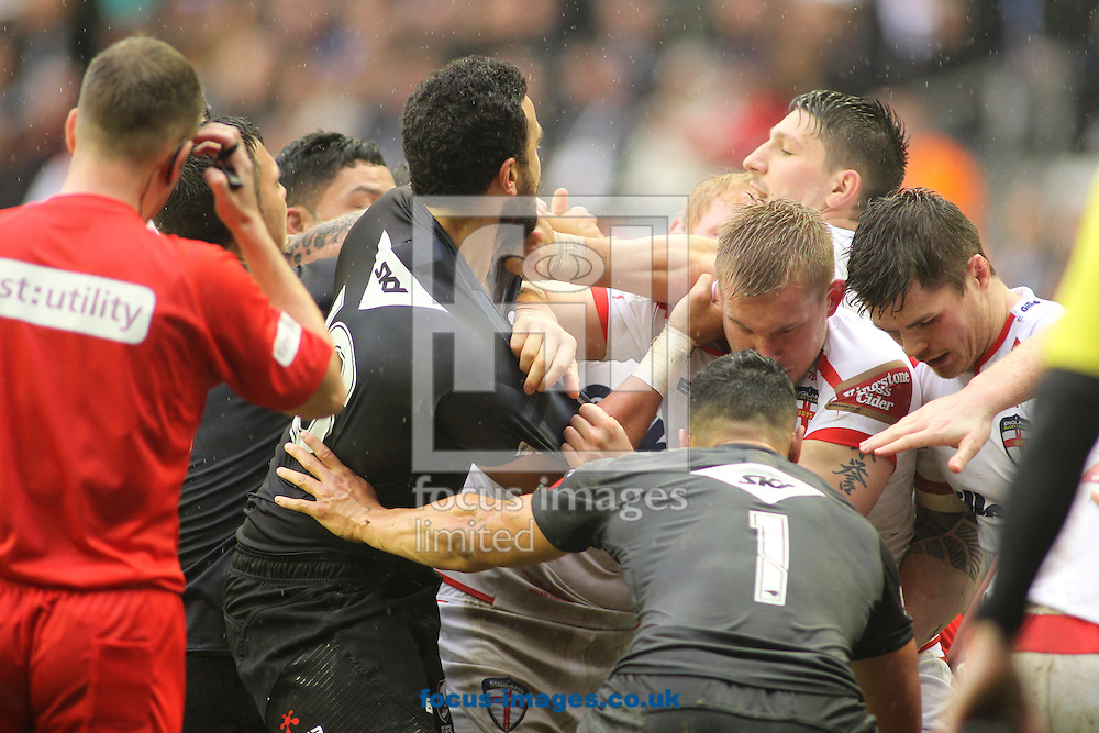 Tempers flair between Mike Cooper (R) of England and Ben Matulino (L) of New Zealand during the Autumn International Series match at the DW Stadium, Wigan<br /> Picture by Stephen Gaunt/Focus Images Ltd +447904 833202<br /> 14/11/2015