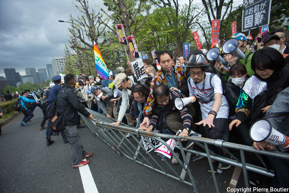 April 14,2018,TOKYO, font of Diet ten thousand japanese people cross barricades during rally  call for the resignation of prime minister cabinet over  cronyism  scandal and favoritism  scandal. Akie Abe first lady  used  her husband  influence for obtain hugue discount to acquire a land of  nationalist school  at Osaka 85 per cent over the regular market prices,and prime minister Shinzo Abe is  suspected to use his influence to help close friend Kotaro Kake to win approval for  opening a vetenary school  in Ehime prefecture in special deregulation zone  .Pierre Boutier