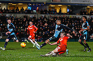 Scott Griffiths of Luton Town shoots while under pressure from Paris Cowan-Hall of Wycombe Wanderers during the Sky Bet League 2 match at Adams Park, High Wycombe<br /> Picture by David Horn/Focus Images Ltd +44 7545 970036<br /> 26/12/2014