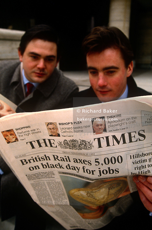 Businessmen associates together read The Times newspaper in the early 90s when the News International title was a broadsheet - before it went to a tabloid format. The headline refers to a British Rail axing of 5,000 jobs. The Times is a British daily national newspaper, first published in London in 1785 under the title The Daily Universal Register (it became The Times on 1 January 1788). The Times and its sister paper The Sunday Times (founded in 1821) are published by Times Newspapers, since 1981 a subsidiary of News International, itself wholly owned by the News Corporation group headed by Rupert Murdoch.