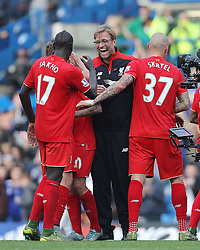 Liverpool Manager Jurgen Klopp celebrates with Mamadou Sakho and Martin Skrtel of Liverpool ( R ) after they win the match - Mandatory byline: Paul Terry/JMP - 07966 386802 - 31/10/2015 - FOOTBALL - Stamford Bridge - London, England - Chelsea v Liverpool - Barclays Premier League