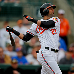 Mar 1, 2013; Sarasota, FL, USA; Baltimore Orioles right fielder Nick Markakis (21) flies out against the Pittsburgh Pirates during the bottom of the first inning of a spring training game at Ed Smith Stadium. Mandatory Credit: Derick E. Hingle-USA TODAY Sports
