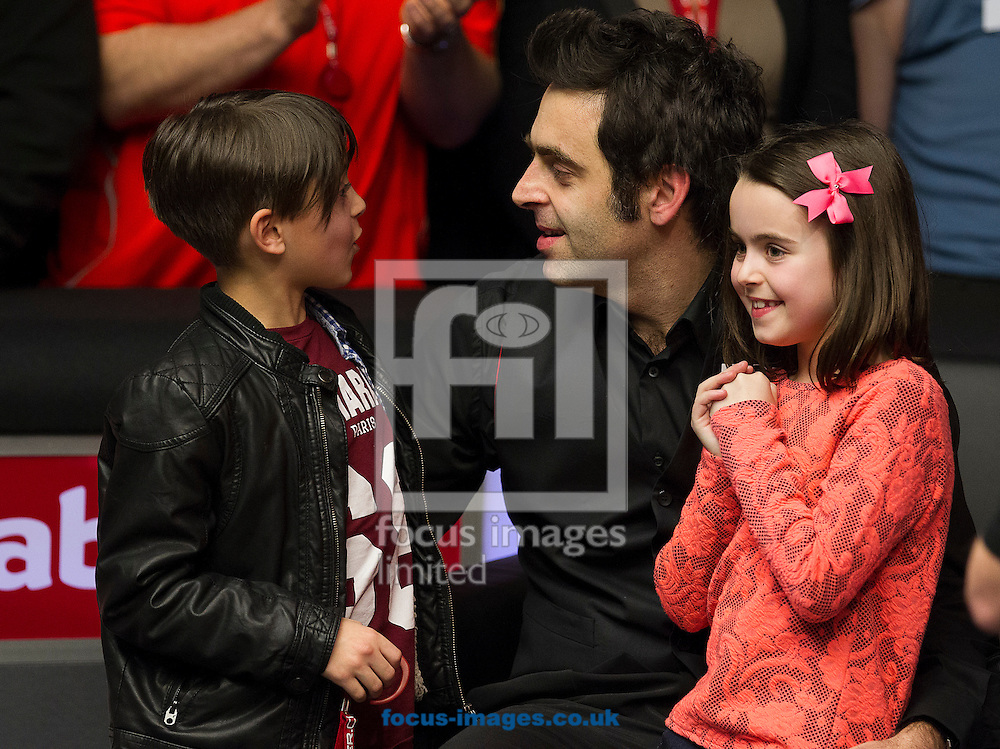 Picture by Paul Terry/Focus Images Ltd +44 7545 642257<br /> 19/01/2014<br /> Ronnie O'Sullivan celebrates with his son Ronnie Jnr and Daughter Lily after winning The Masters final at Alexandra Palace, London.