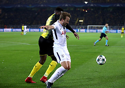 Borussia Dortmund's Dan-Axel Zagadou and Tottenham Hotspur's Harry Kane (right) battle for the ball