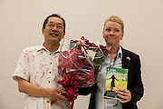"Ex SDP politian, Ryoichi Hattori (left) presents flowers to rape Survivor and activist, Catherine ""Jane"" Fisher at a press conference to publicise her book  in the First Office Building of the Members of the House of Representatives, Nagatacho, Tokyo, Japan, Friday July 18th 2014. Ms Fisher was raped near Yokusuka US Naval Base in Kanagawa in 2002 and has been campaign for the rights of rape victims in Japan since after finding the US Military and Japanese police obstructive and uninterested in bringing her attacker to justice."