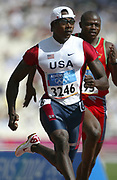 Shawn Crawford of the United States wins first-round heat of the 100 meters in 10.02 in the 2004 Olympics in Athens, Greece on Saturday, August 21, 2004.