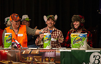 "The ""Bounty Hunters"" from Gilford High School Jessica Bishop, Anthony Sperazzo and Louise Jagusch correctly spell sophomore to make it to the next round during the 19th annual Lakes Region Scholarship Foundation's Spelling Bee at LHS on Thursday evening.  (Karen Bobotas/for the Laconia Daily Sun)"