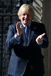 © Licensed to London News Pictures. 05/07/2020. London, UK. British Prime Minister Boris Johnson claps outside Downing St to mark the 72nd anniversary and to thank staff for their work in tackling the coronavirus pandemic. Photo credit: Ray Tang/LNP