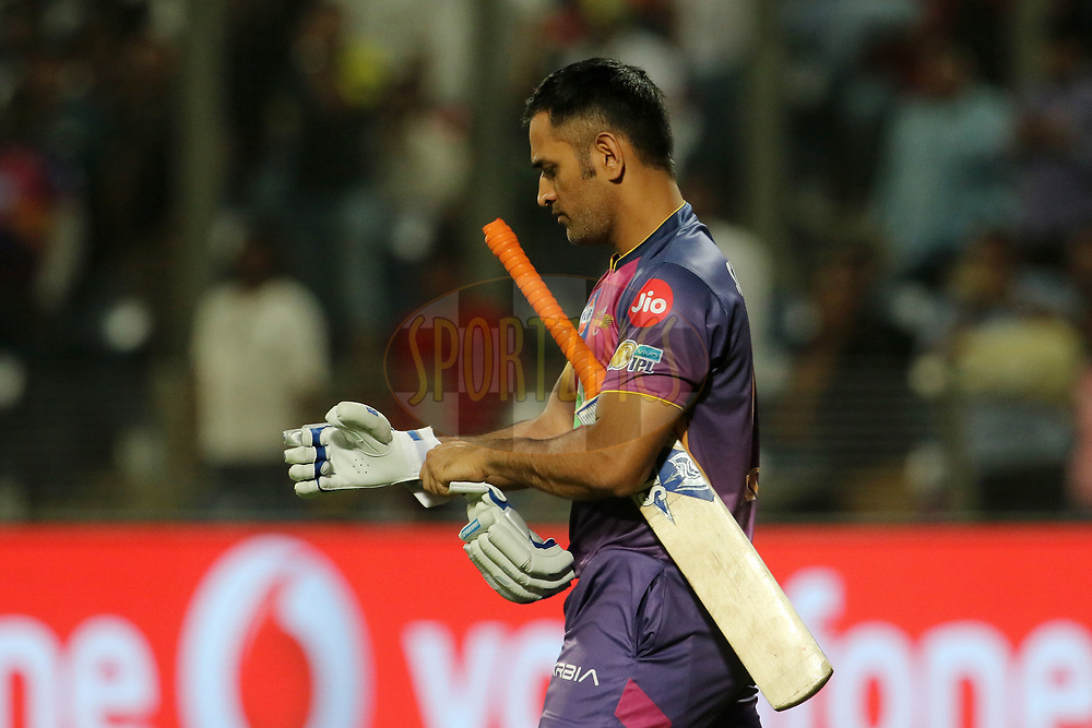 MS Dhoni of Rising Pune Supergiant arrives to the field of play after the wicket of Faf du Plessis of Rising Pune Supergiant during match 9 of the Vivo 2017 Indian Premier League between the Rising Pune Supergiants and the Delhi Daredevils held at the MCA Pune International Cricket Stadium in Pune, India on the 11th April 2017<br /> <br /> Photo by Vipin Pawar- IPL - Sportzpics
