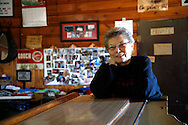 Elsie Eiler talks with a visitor in the tavern she runs in the village of Monowi, Nebraska April 27, 2011. Eiler is the person living in Monowi making it the only incorporated town, village or city in the United States with only one resident.  REUTERS/Rick Wilking (UNITED STATES)