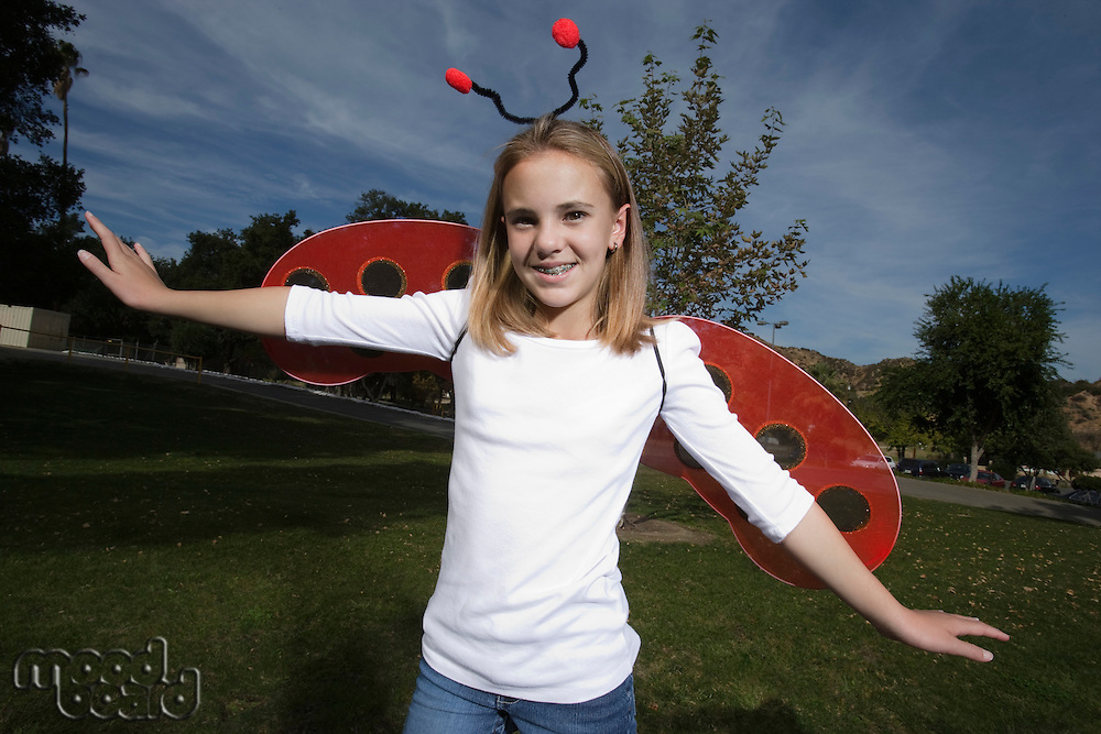 Portrait of girl (10-12) wearing ladybug costume