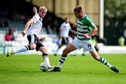Yeovil Town's Sam Foley is challenged by Doncaster Rovers' David Syers - Photo mandatory by-line: Dougie Allward/Josephmeredith.com  - Tel: Mobile:07966 386802 01/09/2012 - SPORT - FOOTBALL - League 1 -  Yeovil  - Huish Park -  Yeovil Town v Doncaster Rovers
