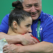 Gymnastics - Olympics: Day 6  Alexandra Raisman #395 of the United States is embraced by her coach Mihai Brestyan after winning the silver medal during the Artistic Gymnastics Women's Individual All-Around Final at the Rio Olympic Arena on August 11, 2016 in Rio de Janeiro, Brazil. (Photo by Tim Clayton/Corbis via Getty Images)