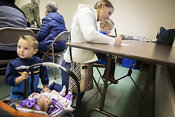 Mary Menne, with her children Peter, from left, 4, Josephine, five months, and Isaac, 2, fills out her ballot at St. Joseph's Catholic Church Parish Center in Henderson, Minn.Photo by Leila Navidi/Minneapolis Star Tribune/TNS/ABACAPRESS.COM