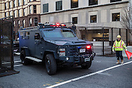 A police vehicle passes through security barriers set up downtown ahead of inauguration of President Barack Obama on Sunday, January 20, 2013 in Washington, DC.