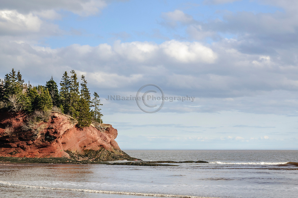 Beautiful red rock cliff overlooking the Bay of Fundy in St-Martins, New Brunswick Canada