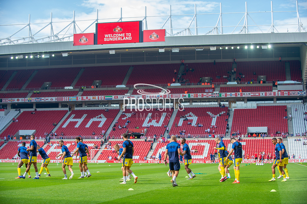 AFC Wimbledon players warm up before the EFL Sky Bet League 1 match between Sunderland and AFC Wimbledon at the Stadium Of Light, Sunderland, England on 24 August 2019.