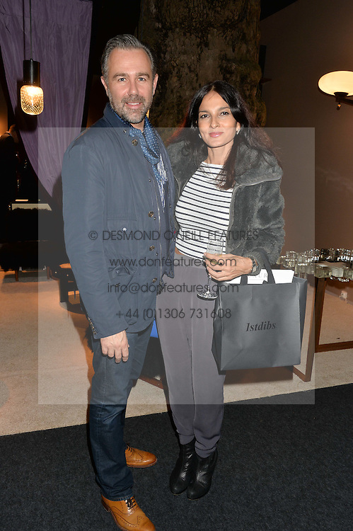 Left to right, YASMIN MILLS and MARK NEWNS at the PAD London 2014 VIP evening held in the PAD Pavilion, Berkeley Square, London on 14th October 2014.