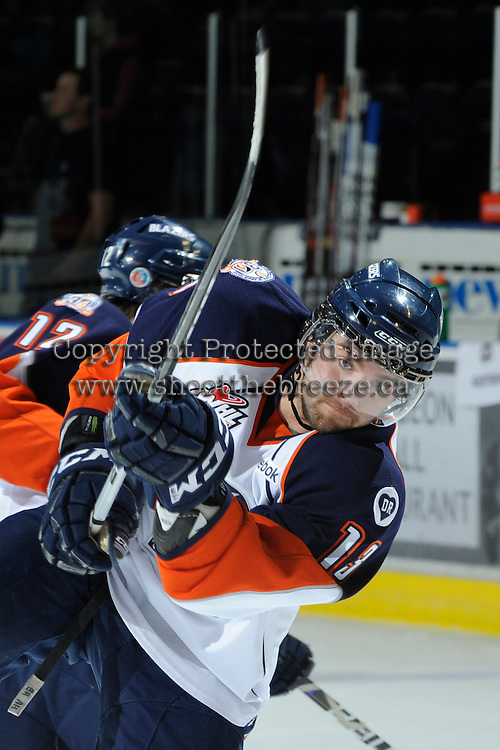 KELOWNA, CANADA, OCTOBER 29: Ryan Hanes #13 of the Kamloops Blazers warms up on the ice as the Kamloops Blazers visit the Kelowna Rockets  on October 29, 2011 at Prospera Place in Kelowna, British Columbia, Canada (Photo by Marissa Baecker/Shoot the Breeze) *** Local Caption *** Ryan Hanes;